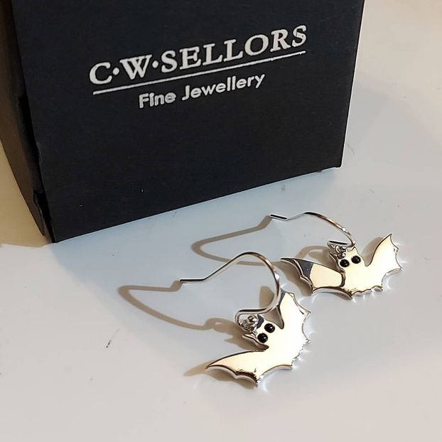 STERLING SILVER WHITBY JET SMALL BAT HOOK EARRINGS.